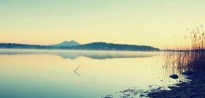 Beautiful sunrise at empty beach, Mediterranean Sea island. Peaceful water level makes blue mirror